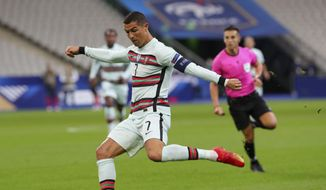 Portugal's Cristiano Ronaldo attempts a shot at goal during the UEFA Nations League soccer match between France and Portugal at the Stade de France in Saint-Denis, north of Paris, France, Sunday, Oct. 11, 2020. (AP Photo/Thibault Camus)  **FiLE**