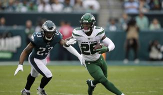 This Oct. 6, 2019, file photo shows New York Jets' Le'Veon Bell, right, rushing past Philadelphia Eagles' Rodney McLeod during the first half of an NFL football game in Philadelphia. The New York Jets have surprisingly released Bell, ending a disappointing tenure after less than two full seasons. The team issued a statement from general manager Joe Douglas on Tuesday, Oct. 13, 2020, in which he says the Jets made the move after having several conversations with Bell and his agent during the last few days and exploring trade options. (AP Photo/Matt Rourke, File)  **FILE**