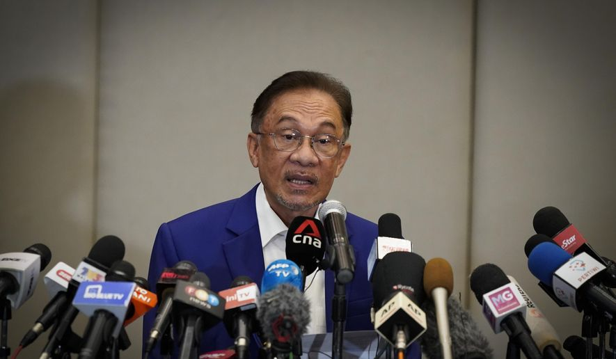 Malaysian opposition leader Anwar Ibrahim speaks during a press conference after meeting the nation's king in Kuala Lumpur, Malaysia, Tuesday, Oct. 13, 2020. Anwar met the king Tuesday in a bid to form a new government after claiming he had secured a majority in Parliament. (AP Photo/Vincent Thian)
