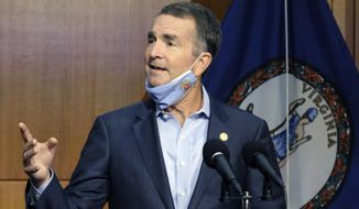 In this Sept. 1, 2020, photo, Virginia Gov. Ralph Northam answers a reporter's question during a news briefing in Richmond. (Bob Brown/Richmond Times-Dispatch via AP) **FILE**