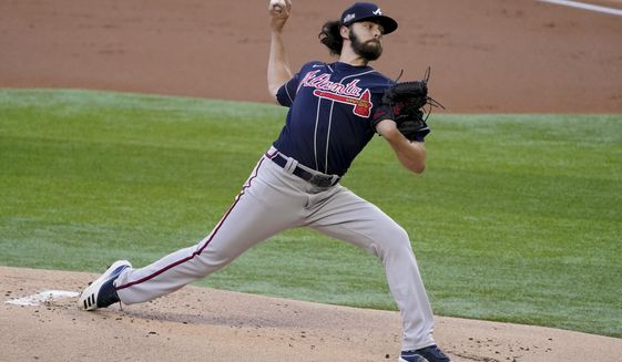 Atlanta Braves starting pitcher Ian Anderson throws against the Los Angeles Dodgers during the first inning in Game 2 of a baseball National League Championship Series Tuesday, Oct. 13, 2020, in Arlington, Texas. (AP Photo/Tony Gutierrez)