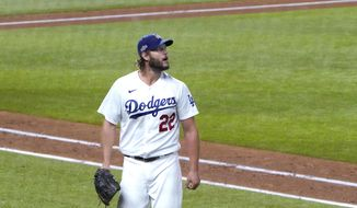 Los Angeles Dodgers starting pitcher Clayton Kershaw heads to the dugout after completing the top of the sixth inning against the San Diego Padres in Game 2 of a baseball National League Division Series Wednesday, Oct. 7, 2020, in Arlington, Texas. (AP Photo/Sue Ogrocki)