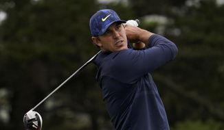 This Aug. 8, 2020, file photo shows Brooks Koepka watching his tee shot on the 14th hole during the third round of the PGA Championship golf tournament at TPC Harding Park in San Francisco. Koepka returns to competition this week after missing two months with a hip injury. (AP Photo/Jeff Chiu, File)  **FILE**