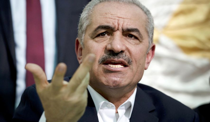 In this Wednesday, Jun. 24, 2020 file photo, Palestinian Prime Minister Mohammad Shtayyeh speaks during the leadership meeting at the village of Fasayil in Jordan Valley.  (AP Photo/Majdi Mohammed, File)  **FILE**