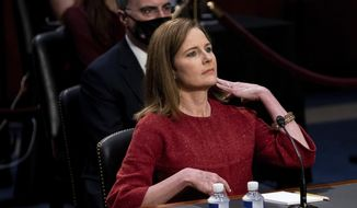 Supreme Court nominee Amy Coney Barrett listens during a confirmation hearing before the Senate Judiciary Committee, Tuesday, Oct. 13, 2020, on Capitol Hill in Washington. (Erin Schaff/The New York Times via AP, Pool)