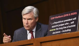 Sen. Sheldon Whitehouse, D-R.I., speaks during a confirmation hearing for Supreme Court nominee Amy Coney Barrett before the Senate Judiciary Committee, Tuesday, Oct. 13, 2020, on Capitol Hill in Washington. (Kevin Dietsch/Pool via AP) ** FILE **