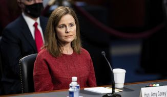 Supreme Court nominee Amy Coney Barrett listens during a confirmation hearing before the Senate Judiciary Committee, Tuesday, Oct. 13, 2020, on Capitol Hill in Washington. (Anna Moneymaker/The New York Times via AP, Pool)