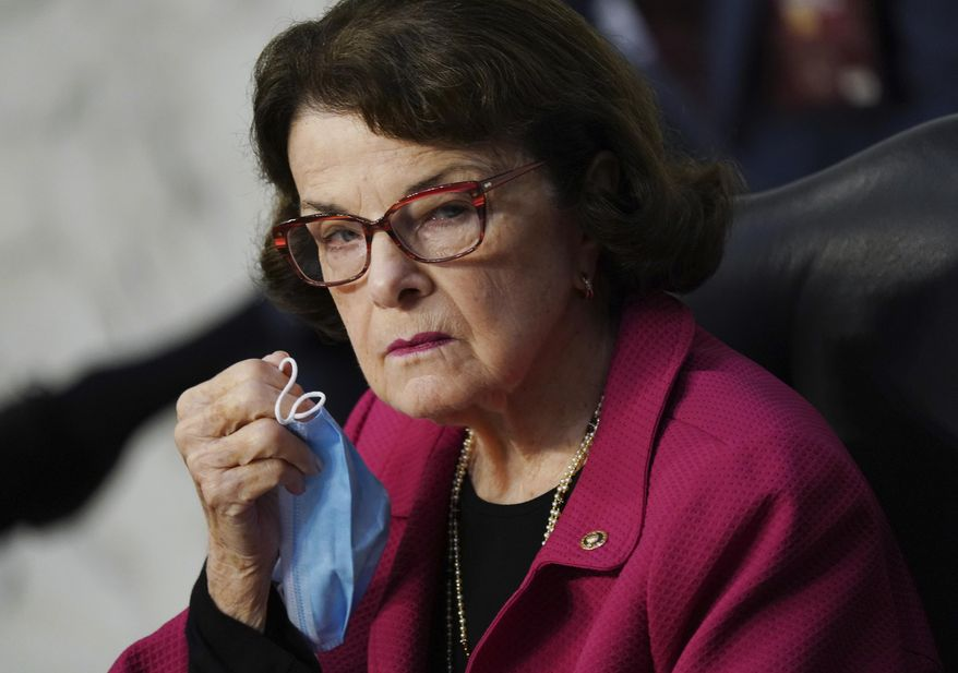 Sen. Dianne Feinstein, D-Calif., holds her face mask during a confirmation hearing for Supreme Court nominee Amy Coney Barrett before the Senate Judiciary Committee, Tuesday, Oct. 13, 2020, on Capitol Hill in Washington. (Kevin Dietsch/Pool via AP)
