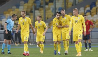 Ukraine's players celebrate their opening goal against Spain during the UEFA Nations League soccer match between Ukraine and Spain at the Olimpiyskiy Stadium in Kyiv, Ukraine, Tuesday, Oct.13, 2020. (AP Photo/Efrem Lukatsky)