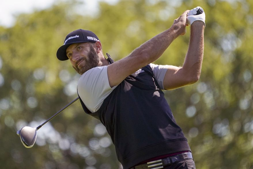 In this Saturday, Sept. 19, 2020, file photo, Dustin Johnson hits from the fourth tee during the third round of the U.S. Open Golf Championship, in Mamaroneck, N.Y. Dustin Johnson withdrew from the CJ Cup at Shadow Creek on Tuesday, Oct. 13, 2020, because of the coronavirus, the most prominent player since golf resumed in June to test positive. The PGA Tour said in a statement that Johnson notified officials he was experiencing COVID-19 symptoms and was given another test that came back positive. (AP Photo/John Minchillo, File)  **FiLE**