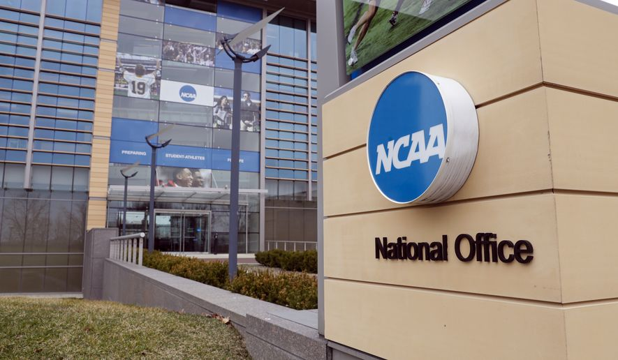 In this March 12, 2020, file photo, the national office of the NCAA in Indianapolis is shown. A set of proposals to permit NCAA athletes to earn money from endorsements and sponsorships deals will go up for vote in January, the last step for the association to change its rules but not the last word on how name, image and likeness compensation will work.   (AP Photo/Michael Conroy, File) **FILE**