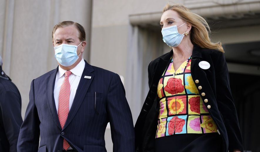 Mark and Patricia McCloskey leave following a court hearing Wednesday, Oct. 14, 2020, in St. Louis. The McCloskeys have pleaded not guilty to two felony charges, unlawful use of a weapon and tampering with evidence, after been seen waving guns at protesters marching on their private street this past summer. (AP Photo/Jeff Roberson)