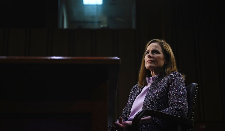 Supreme Court nominee Amy Coney Barrett testifies during the third day of her confirmation hearings before the Senate Judiciary Committee on Capitol Hill in Washington, Wednesday, Oct. 14, 2020.(Andrew Caballero-Reynolds/Pool via AP)