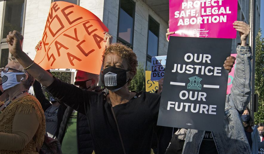 Protesters opposed to the confirmation of President Donald Trump's Supreme Court nominee Amy Coney Barrett, rally on Capitol Hill, in Washington, Wednesday, Oct. 14, 2020. (AP Photo/Jose Luis Magana)