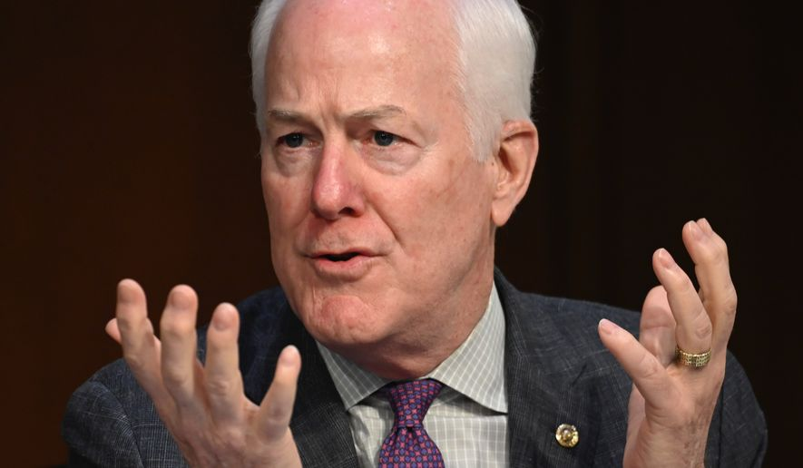 Sen. John Cornyn, R-Texas, questions Supreme Court nominee Amy Coney Barrett during her confirmation hearing before the Senate Judiciary Committee on Capitol Hill in Washington, Wednesday, Oct. 14, 2020. (Andrew Caballero-Reynolds via AP)