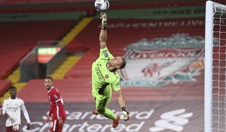 Arsenal's goalkeeper Bernd Leno makes a save during the English League Cup fourth round soccer match between Liverpool and Arsenal at Anfield, Liverpool, England, Thursday, Oct. 1, 2020. (Laurence Griffiths/Pool via AP)