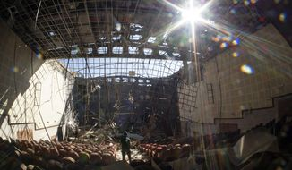 A view of the cultural center, destroyed by shelling during a military conflict, in Shushi, outside Stepanakert, the separatist region of Nagorno-Karabakh, Tuesday, Oct. 13, 2020. The latest outburst of fighting between Azerbaijani and Armenian forces began Sept. 27 and marked the biggest escalation of the decades-old conflict over Nagorno-Karabakh. The region lies in Azerbaijan but has been under control of ethnic Armenian forces backed by Armenia since the end of a separatist war in 1994. (AP Photo)