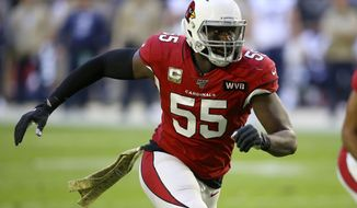 FILE  - In this Sunday, Dec. 1, 2019, file photo, Arizona Cardinals linebacker Chandler Jones (55) lines up against the Los Angeles Rams during the first half of an NFL football game, in Glendale, Ariz. Cardinals All-Pro linebacker Chandler Jones is out for the season because of a biceps injury that requires surgery. An MRI earlier this week confirmed the extent of the injury, which happened during the first half of the team's 30-10 win over the New York Jets on Sunday, and coach Kliff Kingsbury said Wednesday, Oct. 14, 2020, that Jones has elected to have the season-ending surgery. (AP Photo/Ross D. Franklin, File)