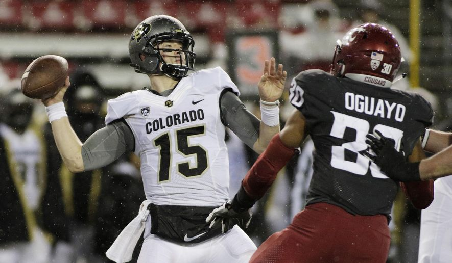 FILE - In this Saturday, Oct. 21, 2017, file photo, Colorado quarterback Sam Noyer (15) throws a pass during the second half of an NCAA college football game against Washington State in Pullman, Wash. Senior Sam Noyer packed up his stuff and left campus. The Colorado Buffaloes quarterback turned safety wanted to be a QB again and was exploring options through the graduate transfer portal. Then, a call from the new coaching staff. Now, he's back and in the mix to be the starting quarterback for the Buffaloes. (AP Photo/Young Kwak, File)