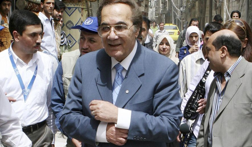 FILE - In this April 15, 2008 file photo, Egyptian actor Mahmoud Yassin, the Good Will Ambassador of the World Food Program, tours Sayyda Zeinab, one of Damascus's suburbs, to check the conditions of Iraqi refugees in Syria. Yassin died at the age of 79 on Oct. 14, 2020. (AP Photo/Bassem Tellawi, File)