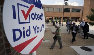 Voters line up outside to cast ballots in the general election at the Henrico County general registrar's office in Henrico County, Va., Friday, Sept. 18, 2020, on the first day of the state's 45-day early voting period. (Bob Brown/Richmond Times-Dispatch via AP) **FILE**