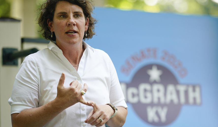 FILE - In this Aug. 25, 2020 file photo, U.S. Senate candidate Amy McGrath holds a rally with supporters during a campaign stop at Woodland Park in Lexington, Ky. Amy McGrath will face US Senate Majority Leader Mitch McConnell on Election Day in November. (AP Photo/Bryan Woolston)