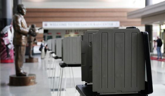 In this file photo, privacy booths are seen at a satellite election office at Temple University's Liacouras Center, on Sept. 29, 2020, in Philadelphia. (AP Photo/Matt Slocum) **FILE**