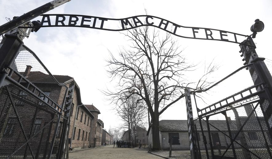 """In this Friday, Feb. 15, 2019, file photo, an entrance gate at the Nazi concentration camp Auschwitz-Birkenau is pictured in Oswiecim, Poland. The sign over the gate reads """"work makes one free"""". (AP Photo/Michael Sohn,file)"""
