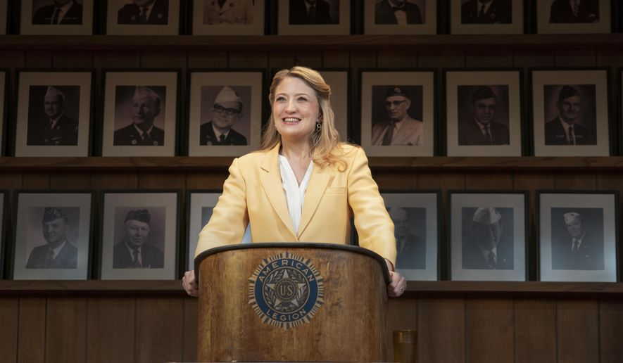 """This image released by Amazon Studios shows Heidi Schreck in a scene from """"What the Conststution Means to Me,"""" which draws on Schreck's experiences as a high-school debate champ and the lives of her female relatives to explore America's principles and the struggle women and minorities have faced to be heard and protected by its founding document. In the work, Schreck calls the Constitution """"a living, warm-blooded, steamy document,"""" but one in which women's bodies were left out """"from the beginning."""" It streams on Amazon on Friday.  (Joan Marcus/Amazon via AP)"""