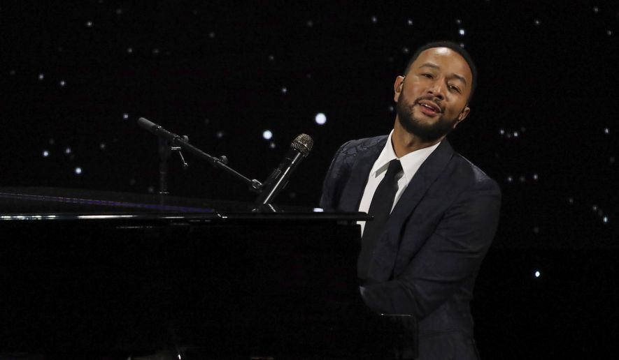 """John Legend performs live on stage at The Alliance for Children's Rights 28th Annual Dinner on March 5, 2020, in Beverly Hills, Calif. Legend dedicated his performance of """"Never Break"""" at the Billboard Music Awards, aired Wednesday, Oct. 14, 2020, to his wife Chrissy Teigen, who recently announced she had a miscarriage. (Photo by Willy Sanjuan/Invision/AP, File)"""