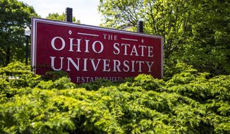 This May 8, 2019, file photo, shows a sign for Ohio State University in Columbus, Ohio. (AP Photo/Angie Wang, File)