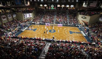 FILE  - In this Nov. 13, 2015, file photo, Iowa State takes on Colorado during an NCAA college basketball game on Heritage Court at the Sanford Pentagon in Sioux Falls, S.D. Four teams that finished last season in the Associated Press Top 25 make up half the field for a three-day tournament Thanksgiving week in South Dakota's largest city. The event will be held Nov. 25-27 at the Sanford Pentagon in Sioux Falls, organizers of the inaugural Bad Boy Mowers Crossover Classic announced Wednesday, Oct. 14, 2020.(AP Photo/Jay Pickthorn, File)