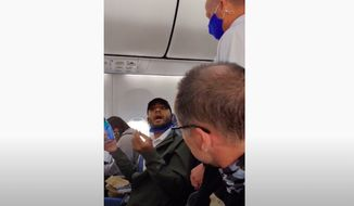 """Donald Trump Jr. on Tuesday slammed a """"disgusting"""" video that showed a Black man in pro-Trump gear being kicked off a Southwest flight for allegedly breaking the airline's mask policy. (Screengrab via YouTube/@KrisAnne Hall JD)"""