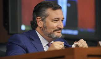Sen. Ted Cruz, R-Texas, reacts to a comment made by Sen. Ben Sasse, R-Neb., about the Houston Astros during the confirmation hearing for Supreme Court nominee Amy Coney Barrett, before the Senate Judiciary Committee, Wednesday, Oct. 14, 2020, on Capitol Hill in Washington. (Greg Nash/Pool via AP)