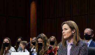 Supreme Court nominee Amy Coney Barrett listens during a confirmation hearing before the Senate Judiciary Committee, Wednesday, Oct. 14, 2020, on Capitol Hill in Washington. (Erin Schaff/The New York Times via AP, Pool)