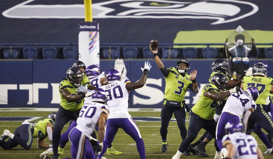 Seattle Seahawks quarterback Russell Wilson passes against the Minnesota Vikings late in the second half of an NFL football game, Sunday, Oct. 11, 2020, in Seattle. (AP Photo/Ted S. Warren)