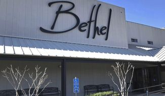 "FILE - This March 2020, file photo shows the Bethel Church in Redding, Calif. The number of cases linked to an evangelical college in Northern California have doubled in the last week to 274 as the school attracts attention on social media for a video by a church leader criticizing masks as ""worthless"" and mocking businesses that enforce wearing face coverings. The school, Bethel School of Supernatural Ministry, is affiliated with Bethel Church, a Redding-based evangelical megachurch. (Mike Chapman/The Record Searchlight via AP, File)"