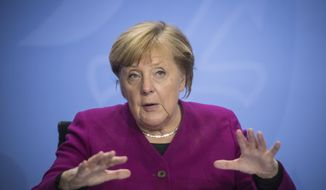 German Chancellor Angela Merkel addresses the media during a press conference after a meeting with the governors of the German states in Berlin, Germany, Wednesday, Oct. 14, 2020. (Stefanie Loos/Pool Photo via AP)