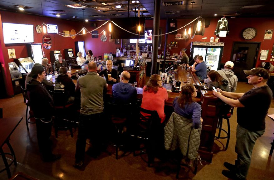 FILE - In this May 13, 2020 file photo, The Dairyland Brew Pub opens to patrons in Appleton, Wis. A Wisconsin judge on Wednesday, Oct. 14, temporarily blocked an order from Gov. Tony Evers' administration limiting the number of people who can gather in bars, restaurants and other indoor places. (William Glasheen/The Post-Crescent via AP File)