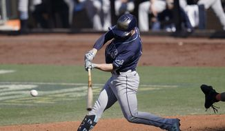 Tampa Bay Rays' Brandon Lowe hits a solo home run against the Houston Astros during the third inning in Game 5 of a baseball American League Championship Series, Thursday, Oct. 15, 2020, in San Diego. (AP Photo/Gregory Bull)  **FILE**