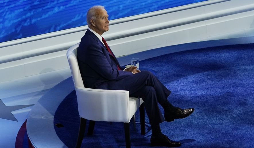 Democratic presidential candidate former Vice President Joe Biden pauses before the start of a town hall with moderator ABC News anchor George Stephanopoulos at the National Constitution Center in Philadelphia, Thursday, Oct. 15, 2020. (AP Photo/Carolyn Kaster)