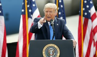 President Donald Trump speaks during a campaign rally in Greenville, N.C., Thursday, Oct. 15, 2020. (AP Photo/Karl DeBlaker)
