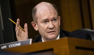 Sen. Chris Coons, D-Del., speaks during the confirmation hearing for Supreme Court nominee Amy Coney Barrett, before the Senate Judiciary Committee, Thursday, Oct. 15, 2020, on Capitol Hill in Washington. (Samuel Corum/Pool via AP)