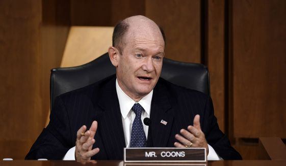 Sen. Chris Coons, D-Del., speaks as the Senate Judiciary Committee hears from legal experts on the final day of the confirmation hearing for Supreme Court nominee Amy Coney Barrett, on Capitol Hill in Washington, Thursday, Oct. 15, 2020. (AP Photo/J. Scott Applewhite)