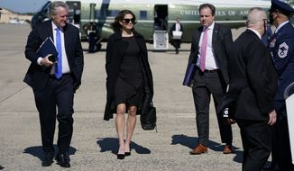 White House chief of staff Mark Meadows, left, and Counselor to the President Hope Hicks, second from left board Air Force one with President Donald Trump aboard for a trip to Greenville, N.C. to attend a campaign rally, Oct. 15, 2020, in Andrews Air Force Base, Md. (AP Photo/Evan Vucci) **FILE**