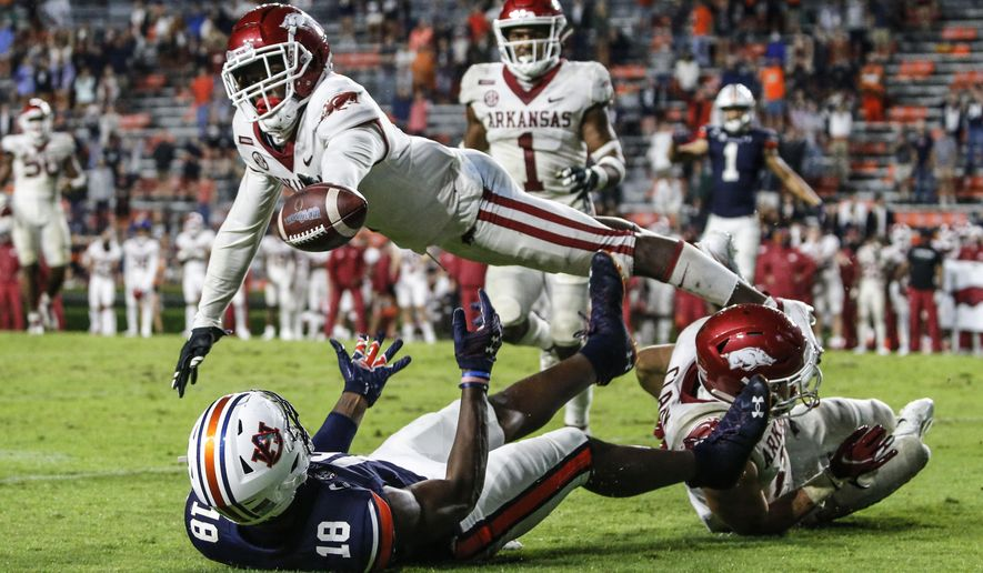 Arkansas defensive back Hudson Clark breaks up a pass intended for Auburn wide receiver Seth Williams (18) during the second half of an NCAA college football game Saturday, Oct. 10, 2020, in Auburn, Ala. (AP Photo/Butch Dill)