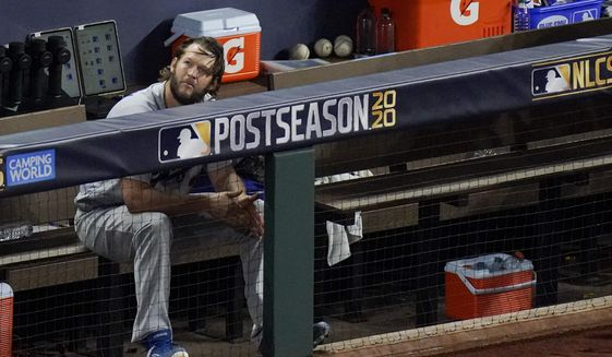 Los Angeles Dodgers starting pitcher Clayton Kershaw sits in the dugout after leaving the game during the sixth inning in Game 4 of a baseball National League Championship Series against the Atlanta Braves Thursday, Oct. 15, 2020, in Arlington, Texas. (AP Photo/Sue Ogrocki)  **FILE**