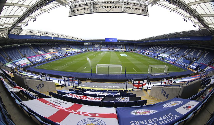 In a photo taken with a wide-angle lens, a general view of empty stands of the King Power Stadium before the English Premier League soccer match between Leicester City and West Ham United, in Leicester, England, Sunday, Oct. 4, 2020. (Nigel French/Pool via AP)