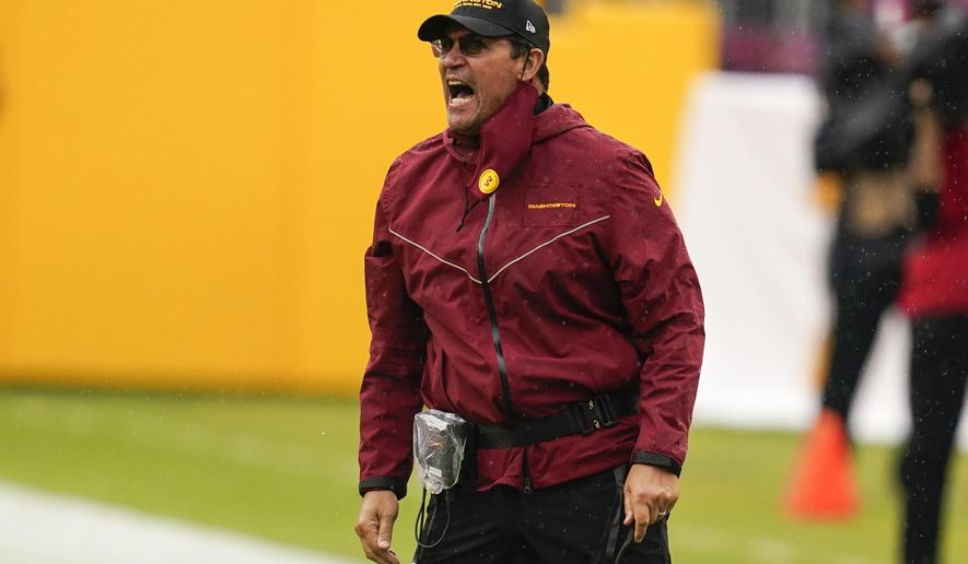 Washington Football Team head coach Ron Rivera reacts during the first half of an NFL football game against the Los Angeles Rams Sunday, Oct. 11, 2020, in Landover, Md. (AP Photo/Steve Helber)