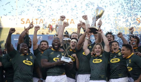 FILE - In this Aug. 10, 2019, file photo, South Africa trammates celebrate at the end of a rugby championship match against Argentina in Salta, Argentina. Rugby Championship organizers SANZAAR on Tuesday, Oct. 13, 2020, have given the World Cup champion South Africa an additional 48 hours to decide whether they will compete in the four-nation tournament in Australia from next month. (AP Photo/Florencia Tanjun, File)